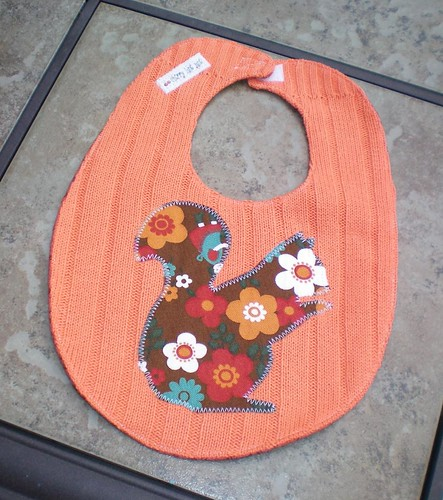 orange squirrel sweater bib
