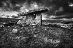 Hole of Sorrows (An diabhal glas) Tags: autumn ireland bw stone canon claire moss ancient irland eire burren dramaticsky irlanda stoneage neolithic dolmen ballyvaughan poulnabrone countyclaire 17mm dramaticclouds efs1785 xti 450d kilnaboy neolithicperiod