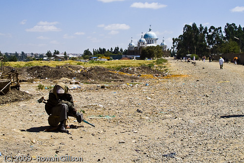 A crippled man begs on the side of a dirt road leading to the orthodox church in Addis Ababa, Ethiopia.