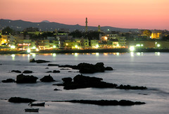 Chania at dusk (eLdudorino) Tags: sea mountains water rock night boats lights boat town rocks nightshot dusk minaret olympus mosque greece crete chania   canea platinumheartaward olympusu820