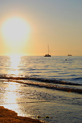 Izola (Sareni) Tags: sunset sea sky sun beach water colors clouds reflections coast boat nikon waves sailing ship july more slovenia sail slovenija 2009 isola jadran twop izola d60 nikond60 jadranskomore sareni