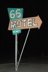 66 motel, needless, ca (Dave van Hulsteyn) Tags: old broken sign bulb vintage peeling paint neon nightshot desert neglected motel noflash 66 route mojave weathered 50s arrow needles googie weatherbeaten imsuregladitisstilltherethough iusedmyheadlights semiabandonedieitisntmaint