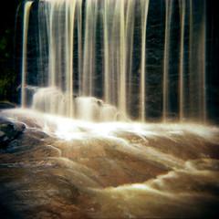 Falling (evanleavitt) Tags: county camera motion mill 6x6 film wet rural creek ga georgia toy waterfall holga rocks long exposure jackson scan medium format spillway 120n sells fujicolor pro400