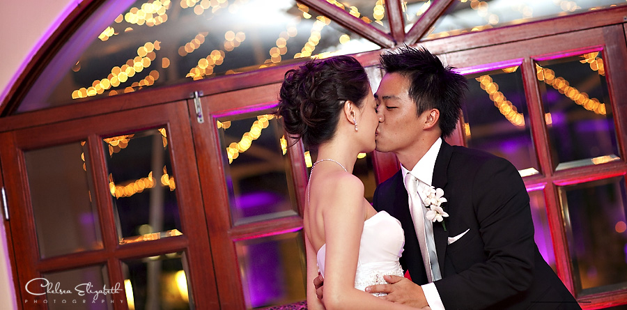 Bride and groom reception kiss picture