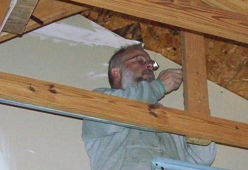 Conduit mounting through garage roof