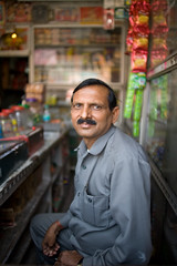 India #31: store manager (zane&inzane) Tags: travel portrait people india man water shop digital store nikon drink f14 28mm documentary environmental chips drinks mineral sucks manager jaipur convenience d3 rajasthan owner wideangleportrait 28f14
