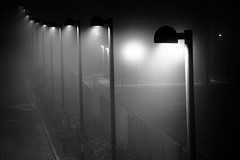 Shedding light... (Elios.k) Tags: light blackandwhite italy mist horizontal fog night dark heart post perspective nopeople row bologna visibility pixopolitan