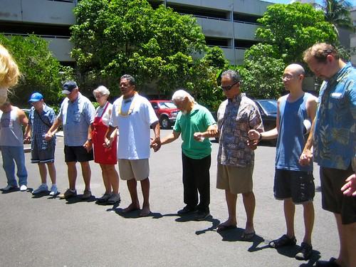 Volunteers praying for Waikiki before the Meet Your Neighbor Cookout