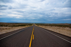 The Long Road (Corey Leopold) Tags: road clouds landscape outdoors vanishingpoint long desert stripe boring strait chihuahuandesert k10d coreyleopold