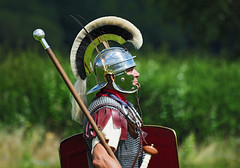 Roman Soldier, Ermine Street Guard, Kelmarsh Festival of History 2009 (Steve Greaves) Tags: red italy rome green leather silver soldier army gold italian ancient war uniform catchycolours dress arms roman juliuscaesar bokeh sandals military helmet battle event staff sword imperial conflict historical stick shield recreation armour period invasion reenactment troops romanempire reenactors authentic legion romans invading armoury chainmail reconstruction invaders cohort legionary spear headdress horsehair plume headgear livinghistory reenacting warfare englishheritage kelmarsh erminestreetguard gladius battledress kelmarshhall paxromana nikond300 fightingforce 43ad