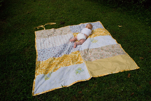 baby on beach blanket to go