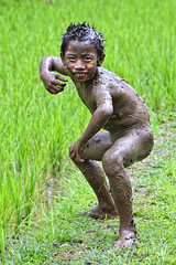 Abangan, Bali - New Zealand Haka Dance ? (Mio Cade) Tags: boy bali wet river pose indonesia fun dance kid child mud joy muddy ubud haka abangan