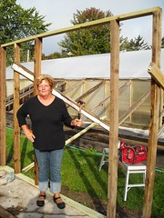 Lori, her hammer, and the first wall (D. Bjorn, Catchin' Up) Tags: wood autumn building me dad tools september lori 2009 pottingshed toomuchfun salvagedwood lorisgreenhouse