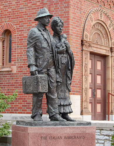 The Italian Immigrants statue, at Saint Ambrose Roman Catholic Church, in the Hill neighborhood of Saint Louis, Missouri, USA