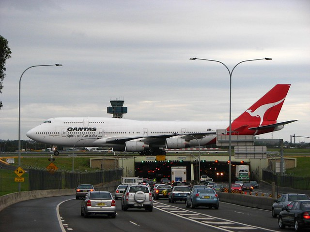 Airplane over road cars Australia Qantas