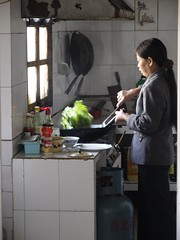Mrs. Hu prepares lunch
