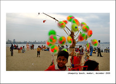 (Sandip Debnath) Tags: boy sea portrait sky india eye boys girl face look shop skyline children eyes sand asia child shore bombay local mumbai journalism hawker streetvendor sandip sandbeach marinedrive arabiansea chowpatti streetbusker sandipdebnath