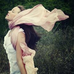 Silk Wind (Laine Apine) Tags: portrait green girl scarf outdoors sitting wind feel windy naturallight silkscarf emotions bushes feelings brownhair whiteblouse