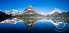 Swiftcurrent Lake Panoramic, Glacier National Park (jimgoldstein) Tags: blue mist lake reflection green water fog forest landscape rockies gold nationalpark montana scenic panoramic glacier bigsky glaciernationalpark swiftcurrentlake interestingness215 i500 manyglaciers jmggalleries mountgrinnell jimmgoldstein lewisrange canon1dsmarkiii