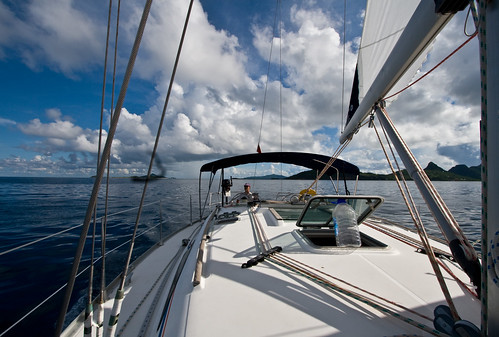 ocean vacation sky water clouds sailboat island boat bottle sailing deck craig caribbean grenadines palmisland rigging ventilation unionisland jeanneausunodyssey40 pythonvoyageri