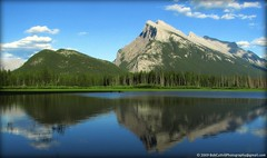 Mount Rundle - First Vermilion Lake, Banff, Alberta (westrock-bob) Tags: park blue trees sunset summer sky sun mountain canada reflection tree water grass set pine golden lakes bob first ab canadian mount most reflect evergreen national alberta hour banff photographed iconic 2009 allrightsreserved westrock vermilion canadien rundle kanada kanata cuthill aplusphoto platinumheartaward westrockbob bobcuthillphotographygmailcom