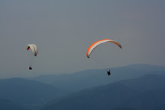 Paragliding Series thermalling (the blind photographer) Tags: friends light summer sky people cloud mountain mountains alps nature sport clouds canon flying bush europe peace lift air scene hills climbing slovenia paragliding cloudbase thermalling kobala
