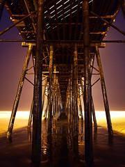 Underneath the Oceanside Pier (Bryce Bradford) Tags: beach night reflections pier long exposure tide low olympus oceanside underneath pillars zuiko f3556 1442mm e520
