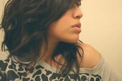 (alma and life) Tags: girl beautiful face digital canon hair rebel 50mm alma profile gray shoulder leaopard xti