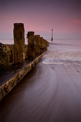 The Evening Tide (Humber Bridge Boy) Tags: longexposure pink sunset sea beach coast movement yorkshire northsea f22 groyne goldenhour eastyorkshire hornsea seadefences longshoredrift alexhay bridlingtonbay canon40d