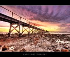 Moonta Bay Jetty, Yorke Peninsula, South Australia :: HDR (Artie | Photography :: I'm a lazy boy :)) Tags: longexposure sunset red sea sky reflection beach water clouds photoshop canon sand rocks cs2 jetty tripod australia wideangle calm clear shore adelaide 1020mm peninsula southaustralia hdr corals yorke foreshore artie moontabay yorkepeninsula moonta 3xp sigmalens photomatix tonemapping tonemap 400d rebelxti moontabayjetty