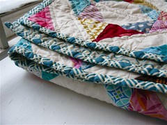 { quilted + bound } ({ philistine made }) Tags: quilting quilts halfsquaretriangles winter2009 geometricsquaresquilt