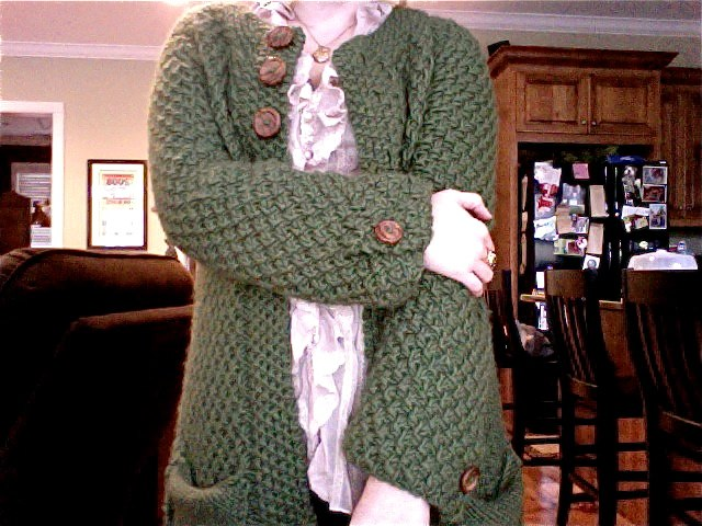 green cardi with buttons