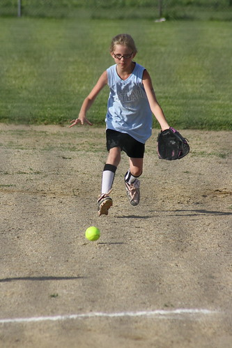 Brenia playing softball