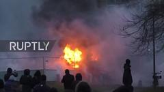متظاهرون في باريس يحرقون سيارات الشرطة بعد الاعتداء على شاب أسود (ahmkbrcom) Tags: اعتداء باريس