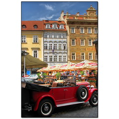 Old Czech cars in Prague (Mike G. K.) Tags: street old red people brick car vintage buildings square geotagged cafe shiny prague convertible praha cobble czechrepublic umbrellas oldtown hdr photomatix 3exp malenamesti geo:lat=5008648 geo:lon=14419701