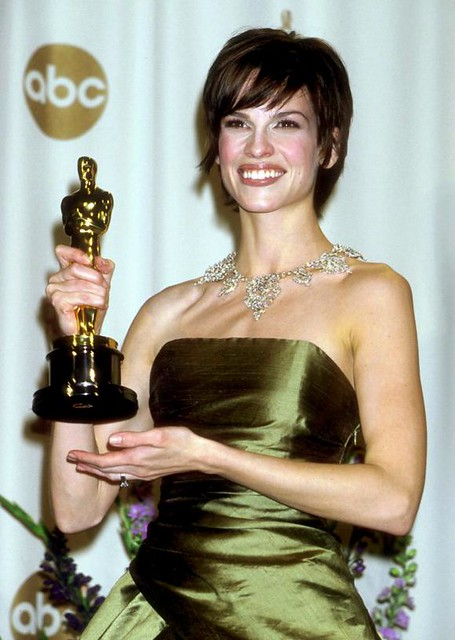 Hilary Swank holding Oscar for Boys Don't Cry by cooperscooperday