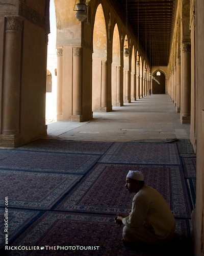 An attendant rests in the shade of the covered arcades at the Ibn Tulun mosque in Cairo, Egypt (photo release is available).