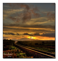train sunset small (riverhouse_foto (Francis Quigley)) Tags: ireland sunset irish train track cork rail railway kerry hdr irishrail rathmore iarnrd ireann iarnrdireann flickraward carrickcameraclub imagesoflightdingle
