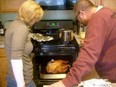 Mom and Dad Check the Turkey