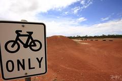 Bike park in the desert (Elena Martinello) Tags: road travel sunset storm art water photo desert australia getty floodway gettyimagesitalyq1 gettyimagesitalyq2 gettyimagesitalyq3