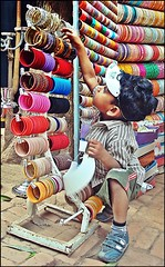 1, 2 , 3... (kalsnchats) Tags: city boy india colors shop kid traditional culture fair counting newdelhi bangles jewellry dillihaat tradefair