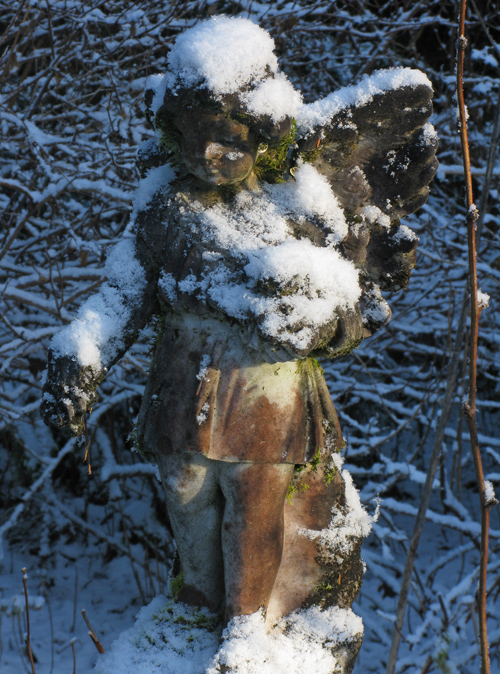 snow on angel on tombstone, Kasaan Cemetery, Kasaan, Alaska