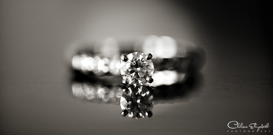 black and white engagement ring detail shot mirror reflection