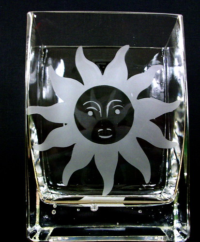glass etched with sun