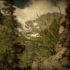 lake path view (jssteak) Tags: trees sky lake snow mountains clouds forest rocks view cliffs trail rmnp legacy textured layered vintagephoto fauxvintage justimagine kartpostal lochlake expressyourselfaward