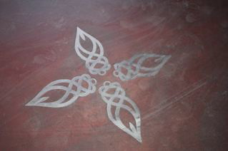 celtic designs inlaid in concrete floor