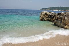 Kassiopi beach (Corfu) (Filip Knei) Tags: blue sea summer green rocks waves greece more albania corfu kerkyra 2009 adriatic ionian grcka krf kerkira albanija topshots plavo talasi  krkyra worldwidelandscapes panoramafotogrfico filipknezic greatshotss ficablok38