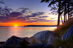 Bass Harbor Sunset (Tyler McCall) Tags: ocean trees sunset sky orange sun seascape nature water rock clouds landscape rocks waves hdr bassharbor mountdesertisland acadianationalpark photomatix canonrebelxs canonefs1855mmf3556is canoneos1000d tylermccall