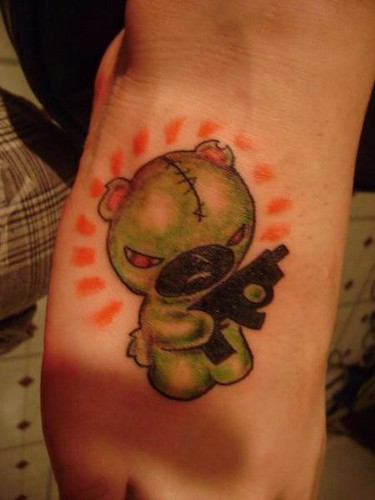 teddybear with gun tattoo. Justin at Kats Like Us Tattoos