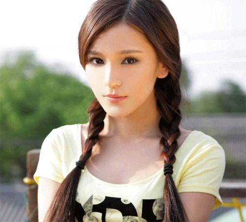 Pretty Asian Woman In 54